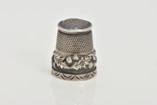 A SILVER THIMBLE, decorated with thistles and set with a possibly chalcedony terminal, hallmarked '