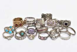 A BAG OF ASSORTED WHITE METAL RINGS, twenty-one rings, some set with paste or semi-precious