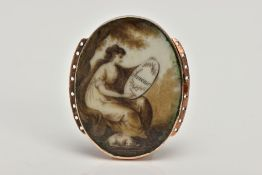 AN EARLY VICTORIAN MEMORIAL BRACELET CLASP, of an oval form, hand painted portrait of a lady sitting