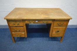 A 20TH CENTURY OAK DESK, with six drawers, width 137cm x depth 76cm x height 76cm (condition - loose