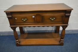 A SOLID OAK MELLOWCRAFT SIDE TABLE with two frieze drawers, turned and block front supports united