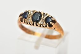 A 9CT GOLD SAPPHIRE AND DIAMOND RING, designed with three graduated oval cut blue sapphires,