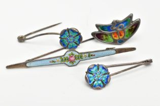 FOUR ARTS AND CRAFTS BROOCHES, to include two 'Pearce & Son' silver brooches, each with a blue and