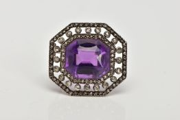 A LATE VICTORIAN AMETHYST AND ROSE CUT DIAMOND BROOCH, centring on a cushion cut amethyst, within an