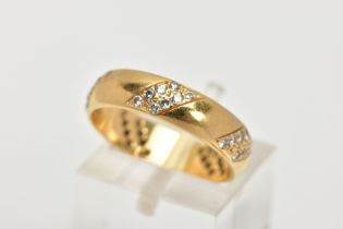 AN 18CT GOLD, DIAMOND WEDDING BAND, designed with five asymmetrical sections, each set with six