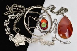 A SILVER BANGLE, TWO PENDANT NECKLACES AND A WHITE METAL BRACELET, the silver hinged bangle,