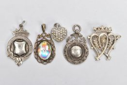 FIVE PIECES OF JEWELLERY, to include a silver fob of a circular form, vacant cartouche, fitted