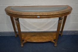 A FRENCH DEMI LUNE HALL TABLE, with a glass insert, on fluted legs, united by an undershelf, width