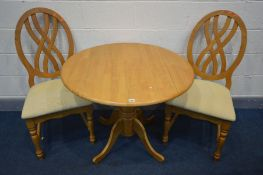 A BEECH DROP LEAF KITCHEN PEDESTAL TABLE, open diameter 92cm x height 73cm and two chairs (3)