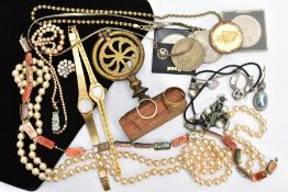 A BAG OF ASSORTED ITEMS, to include a brass ornament fitted to a wooden plinth, imitation pearl