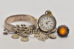 A SELECTION OF SILVER ITEMS, to include a foliate engraved hinged bangle, fitted with a push pin
