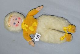 A CLOTH FACED DOLL, painted features, yellow velvet top and shoes, white furry hat and trousers,