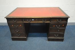 A LARGE REPRODUCTION MAHOGANY PEDESTAL DESK, with a red leather and gilt tooled inlay top, and eight