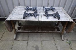A TEAK SLATTED GARDEN TABLE, with drop ends, width 157cm x depth 82cm x height 71cm (losses)