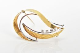 A BI-COLOUR 14CT GOLD DIAMOND BROOCH, open work design set with four single cut diamonds, fitted