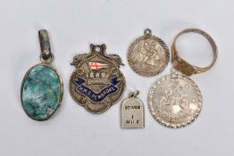 FIVE WHITE METAL PENDANTS AND A RING, to include a white metal St. Christopher pendant stamped '
