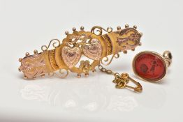 A 9CT GOLD VICTORIAN SWEETHEART BROOCH AND A YELLOW METAL INTAGLIO FOB SEAL, the brooch decorated
