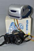 A BOXED POLAROID P-CAM INSTANT CAMERA AND A CANON T70 SLR CAMERA, comprising Canon film camera