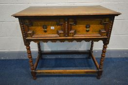 AN OAK SIDE TABLE, two drawers with geometric detail, on bobbin turned legs united by a box