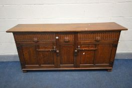 NIGEL GRIFFITHS, A HANDCRAFTED OAK SIDEBOARD, with two long drawers flanking a single short