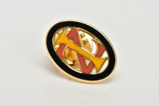 A YELLOW METAL ENAMELLED MONOGRAM PIN, of an oval openwork form, decorated with black, yellow and