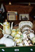 A BOX AND VINTAGE SUITCASE OF CERAMICS AND BOOKS, including Paragon 'Laburnum' tea set (teapot