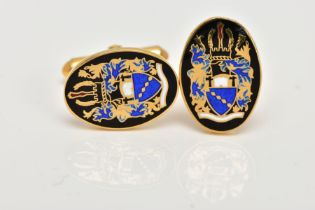 A PAIR OF 9CT GOLD ENAMELLED CUFFLINKS, each of an oval form, decorated with a black, blue, white