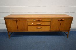 A MID CENTURY DANISH STYLE TEAK 7FT SIDEBOARD, both the fall front cupboard and double cupboard