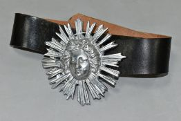 GUY TAPLIN (B.1939) a leather belt with the buckle cast as a lady within a sun burst design, the