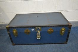 A VINTAGE BLUE TRAVELLING TRUNK (condition - rips to top and bottom) (key)