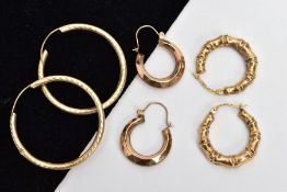 THREE PAIRS OF YELLOW METAL HOOP EARRINGS, the first a pair of bamboo design creole hollow hoops,