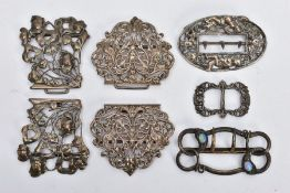 THREE SILVER BUCKLES AND TWO OTHERS, the first of an openwork floral design, hallmarked 'William