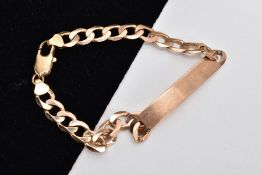 A 9CT GOLD IDENTIFICATION BRACELET, vacant identification panel, on a flat curb link bracelet fitted