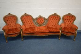 AN ITALIAN THREE PIECE LOUNGE SUITE, with open foliate detail, comprising a three seater settee, and
