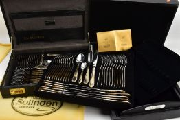 A BRIEF CASE STYLE CANTEEN OF 'SOLINGEN GERMANY' CUTLERY, black briefcase, complete with cutlery,