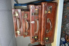 THREE VINTAGE LEATHER SUITCASES, together with a leather look pressed cardboard example, approximate