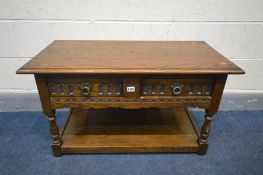 AN OLD CHARM OAK COFFEE TABLE with two drawers, width 92cm x depth 46cm x height 51cm