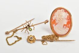 FOUR ITEMS OF JEWELLERY, to include an early 20th century 9ct gold spider bar brooch, collet set