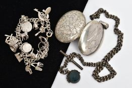 THREE SILVER PIECES OF JEWELLERY, to include a large oval locket, engraved monogram to the front,