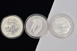 THREE ONE OUNCE SILVER COINS, a one dollar coin, depicting an Australian saltwater crocodile dated