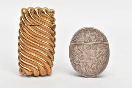 A LATE VICTORIAN SILVER VESTA AND A YELLOW METAL VESTA, the silver vesta of an oval form,