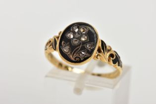 A MID VICTORIAN DIAMOND AND BLACK ENAMEL MEMORIAL RING, the oval ring head with a flower design