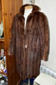 A LADIES CONEY FUR COAT, with hook fastenings at waist and collar, approximate size 12-14,