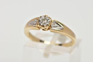 A 9CT GOLD DIAMOND RING, designed with a central illusion set round brilliant cut diamond, flanked