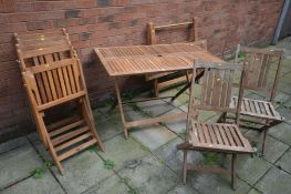 A SET OF SIX WOODEN SLATTED FOLDING DECK CHAIRS together with two matching wooden folding tables,