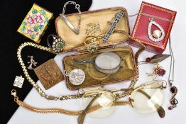 A BAG OF ASSORTED ITEMS, to include a cased pair of folding glasses, a pair of yellow metal framed