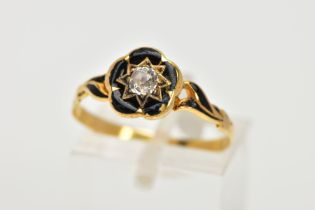 A VICTORIAN, DIAMOND AND BLACK ENAMEL MEMORIAL RING, centring on a star set, old cut diamond