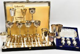 A BOX OF WHITE METAL GOBLETS AND A CANTEEN OF CUTLERY, to include a set of four silver-plate goblets