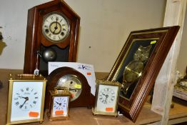 SIX CLOCKS, comprising a late Victorian mantel clock marked 'ST' on the face, with two winding