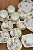 ROYAL ALBERT LAVENDER ROSE PART DINNER SERVICE comprising eight cups and saucers (five cups with